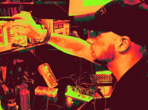 Jerami using an oscilloscope at his desk